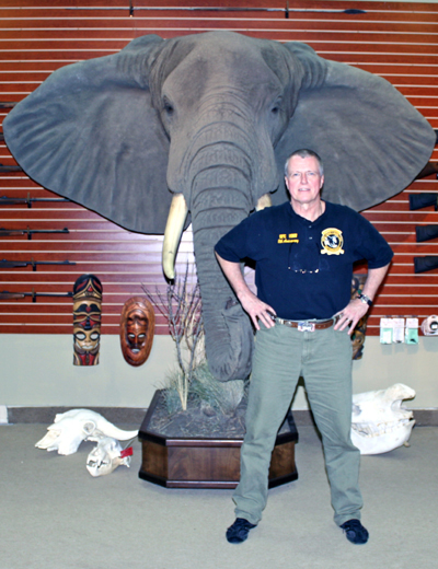 Hock Hochheims standing in front of an African Elephant
